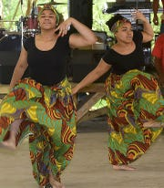 Students perform a traditional dance to begin the Juneteenth Folklife Festival in Louisiana.