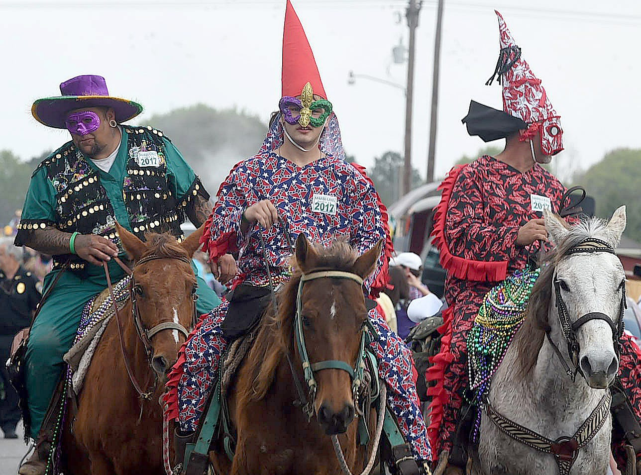 Masked riders line up near the Northwest Community Center Tuesday morning for the start of the Eunice Courir de Mardi Gras 2018