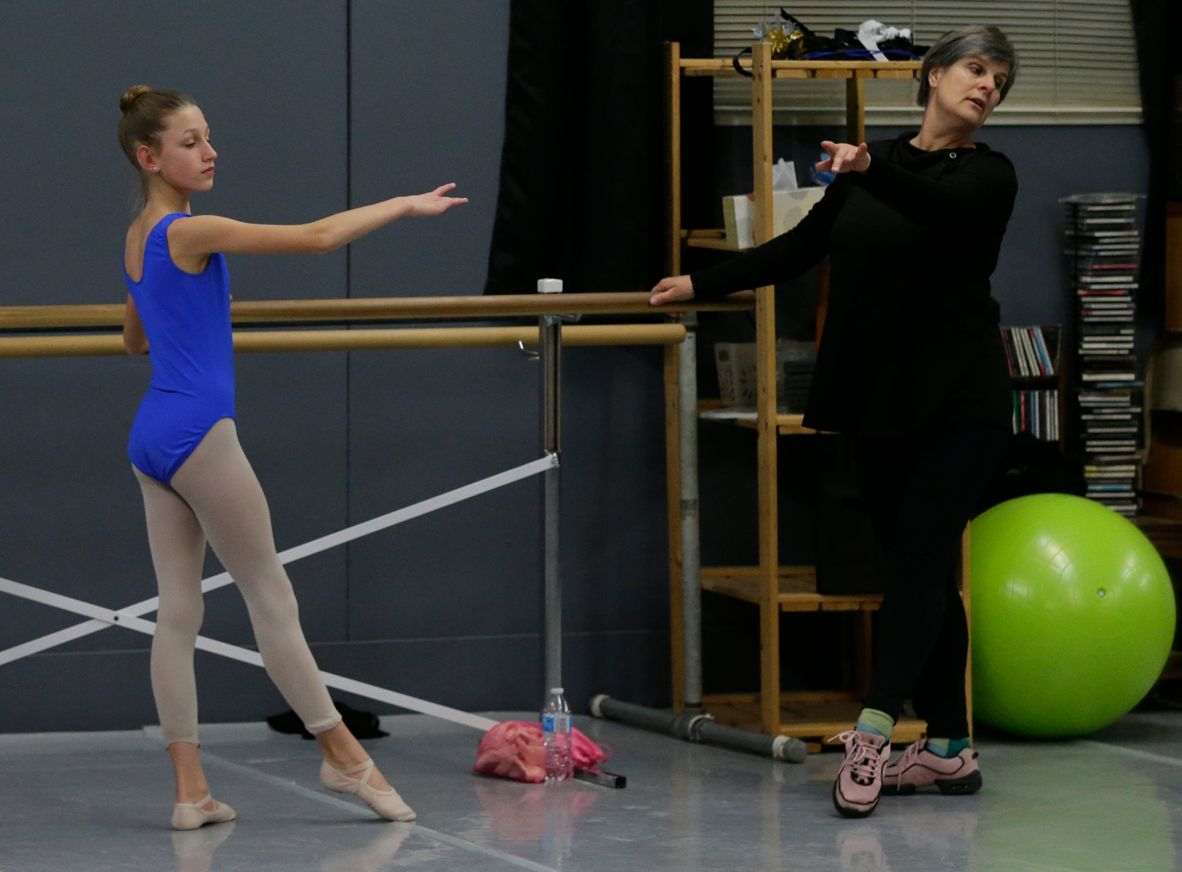 Anne Marie Abderholden works with the dancers.  Dancers practice ballet at Valley Academy of the Arts located at 139 N. Lake Street in Neenah, Wis., Tuesday, December 4, 2018.