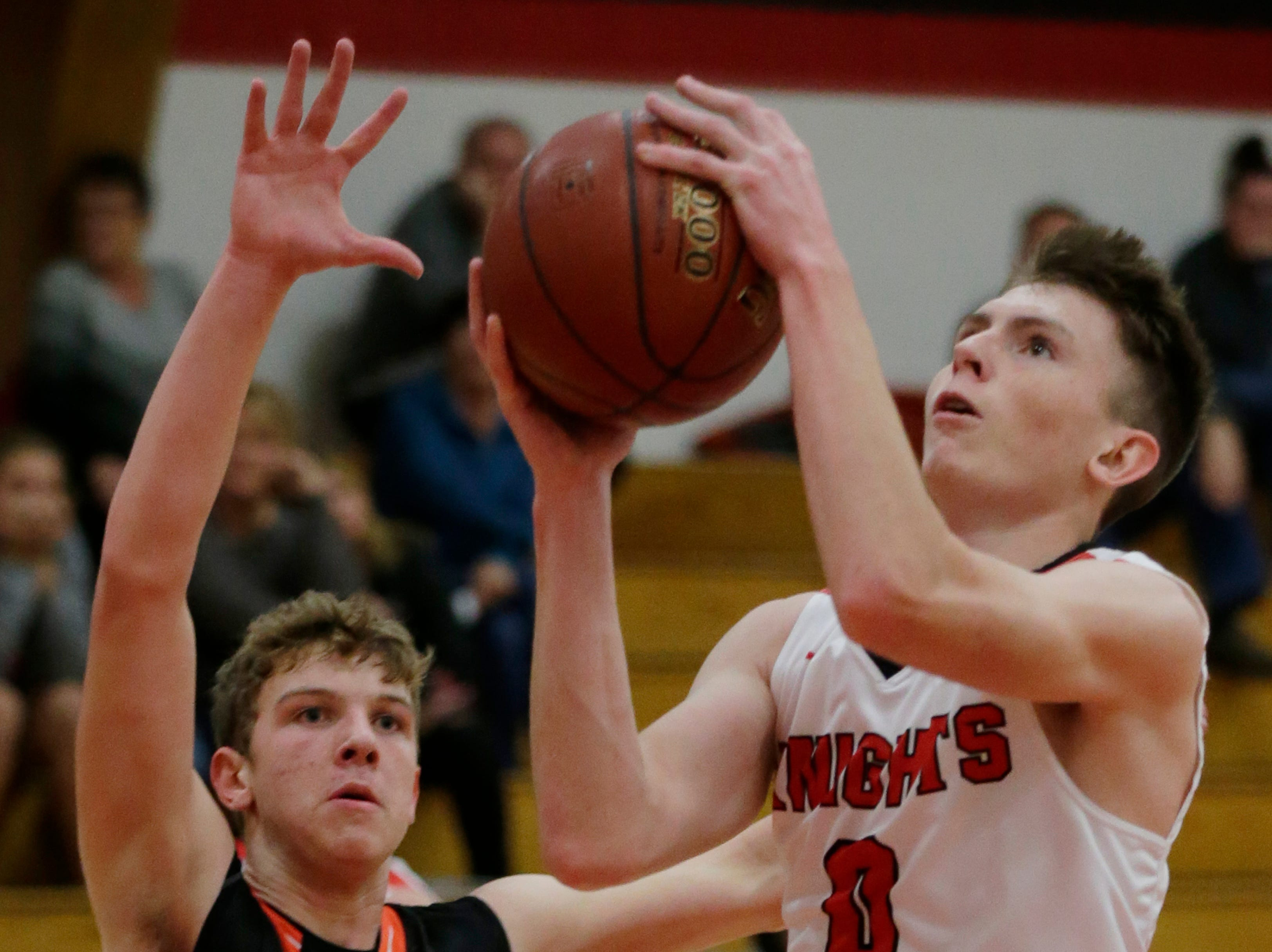 Lourdes Academy's Hayden Jones looks to the basket as he gets ready to shoot. Lourdes Academy Knights played Oakfield Oaks in boys basketball Tuesday, Dec. 4, 2018, at Lourdes Castle in Oshkosh, Wis.