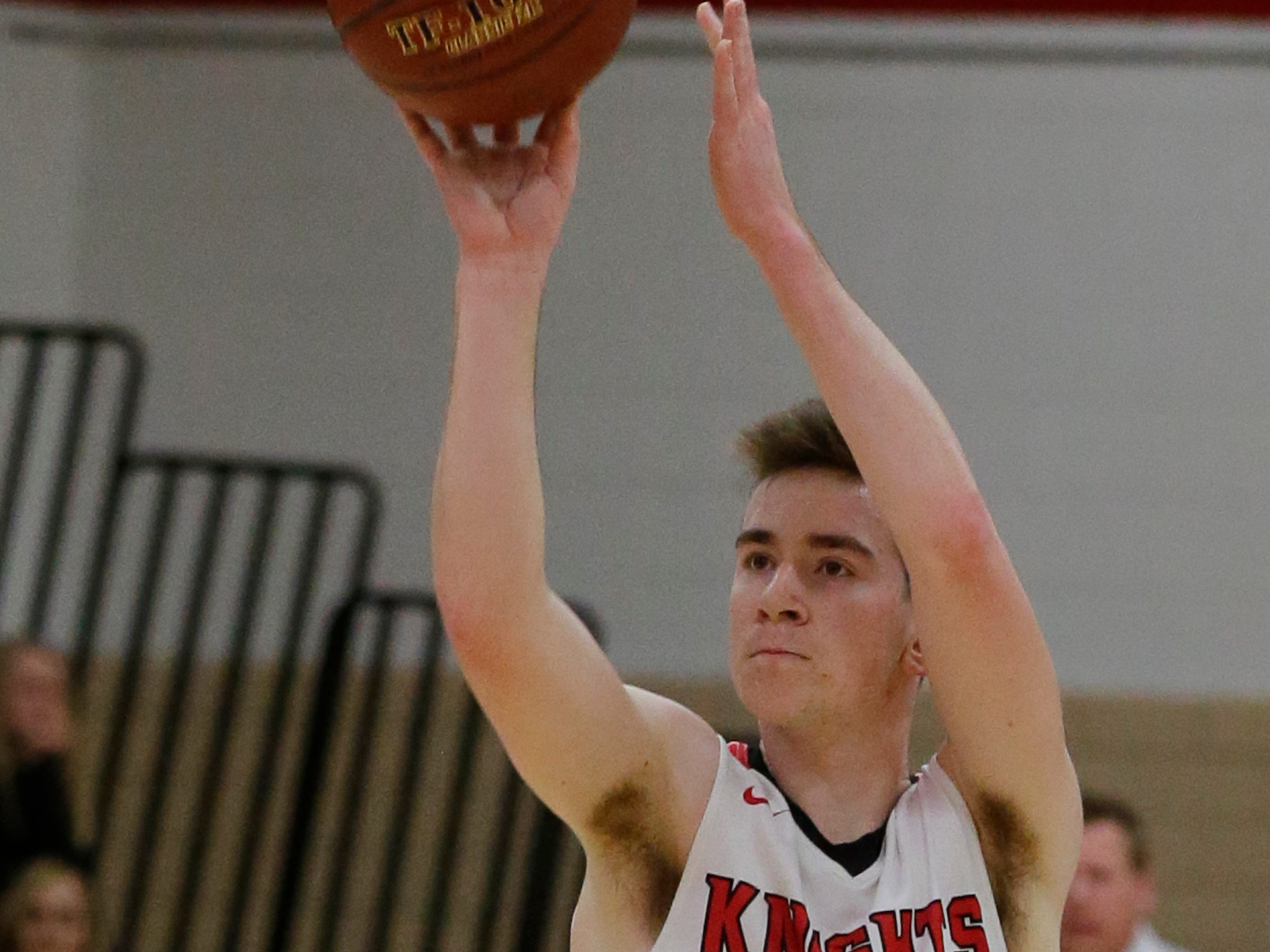 Lourdes Academy's Henry Noone hits a three point shot.  Lourdes Academy Knights played Oakfield Oaks in boys basketball Tuesday, Dec. 4, 2018, at Lourdes Castle in Oshkosh, Wis.