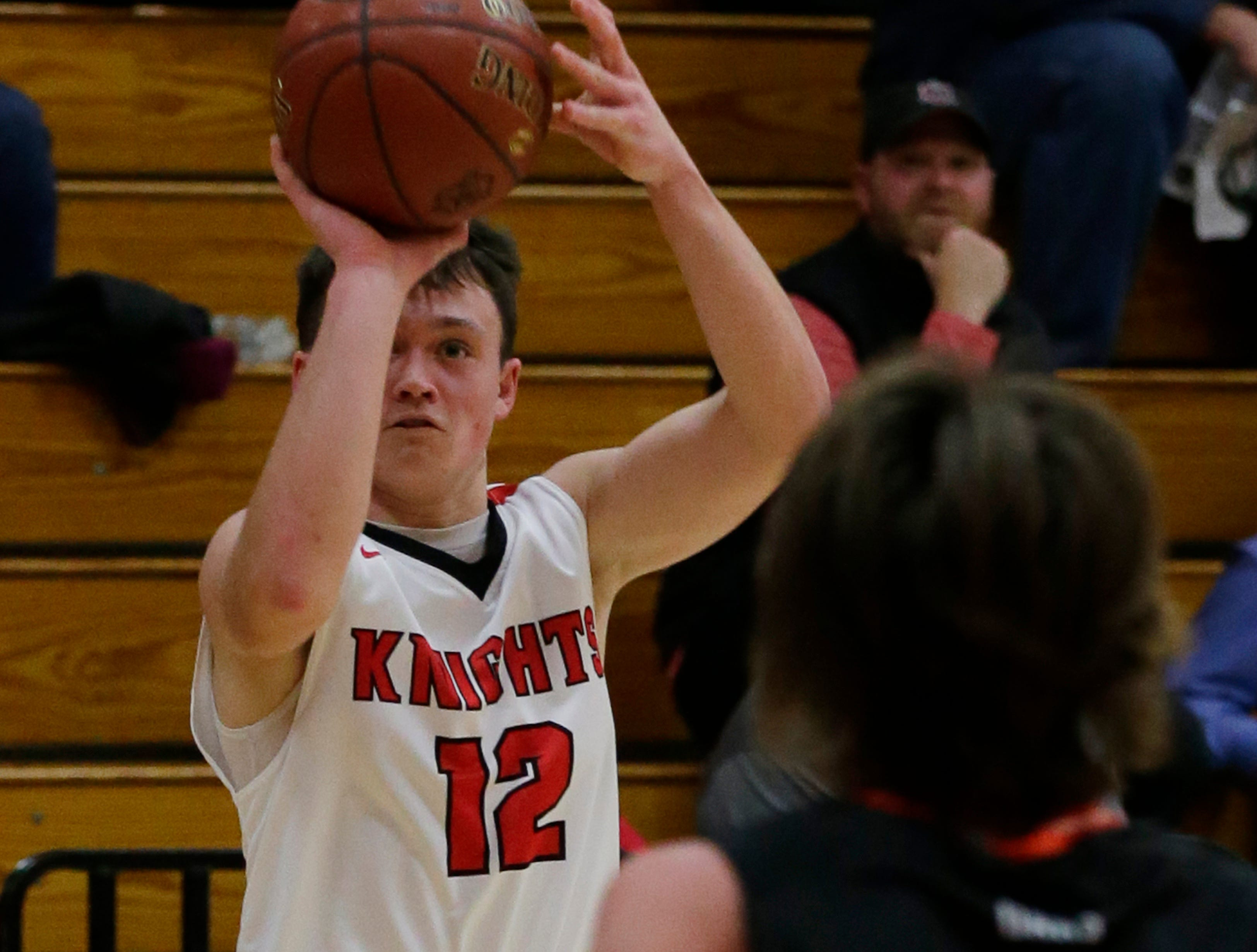 Lourdes Academy's Josh Bauer puts up a three point shot.  Lourdes Academy Knights played Oakfield Oaks in boys basketball Tuesday, Dec. 4, 2018, at Lourdes Castle in Oshkosh, Wis.