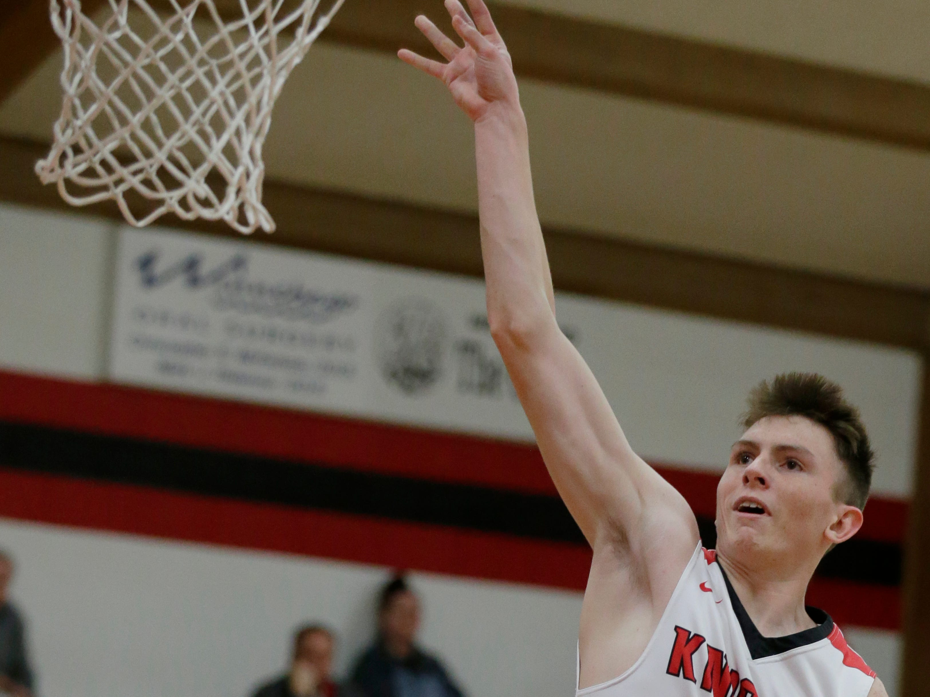 Lourdes Academy's Hayden Jones drives to the inside for a shot and is fouled.  Lourdes Academy Knights played Oakfield Oaks in boys basketball Tuesday, Dec. 4, 2018, at Lourdes Castle in Oshkosh, Wis.