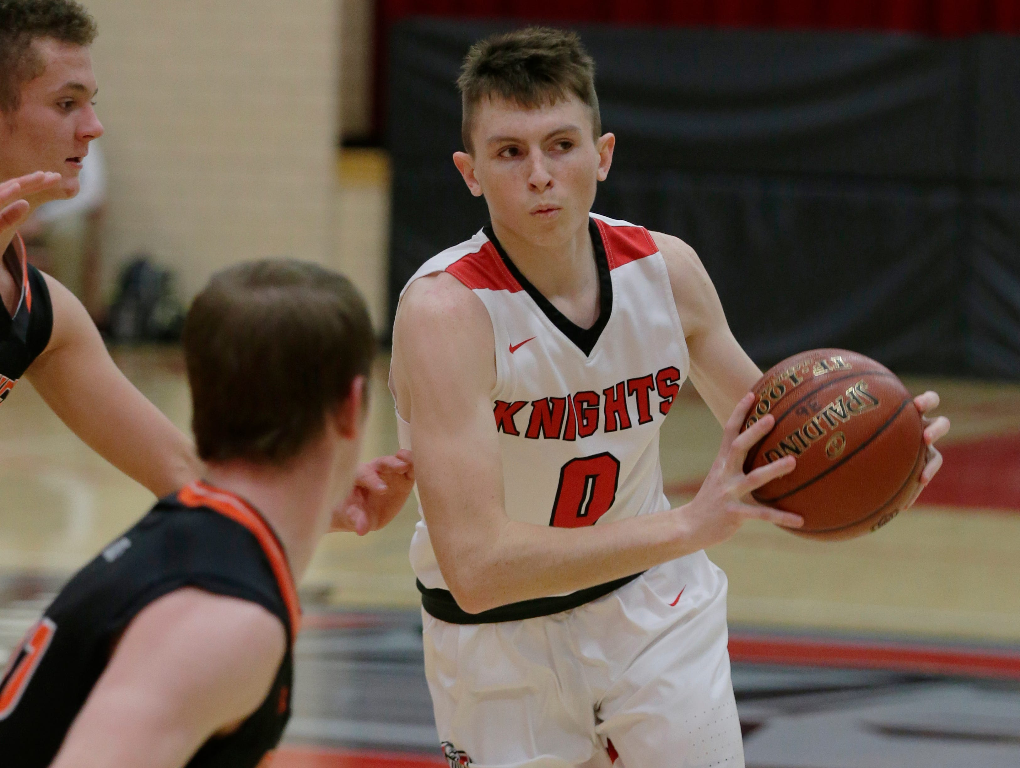 Lourdes Academy's Hayden Jones looks to pass to the outside. Lourdes Academy Knights played Oakfield Oaks in boys basketball Tueday, Dec. 4, 2018, at Lourdes Castle in Oshkosh, Wis.