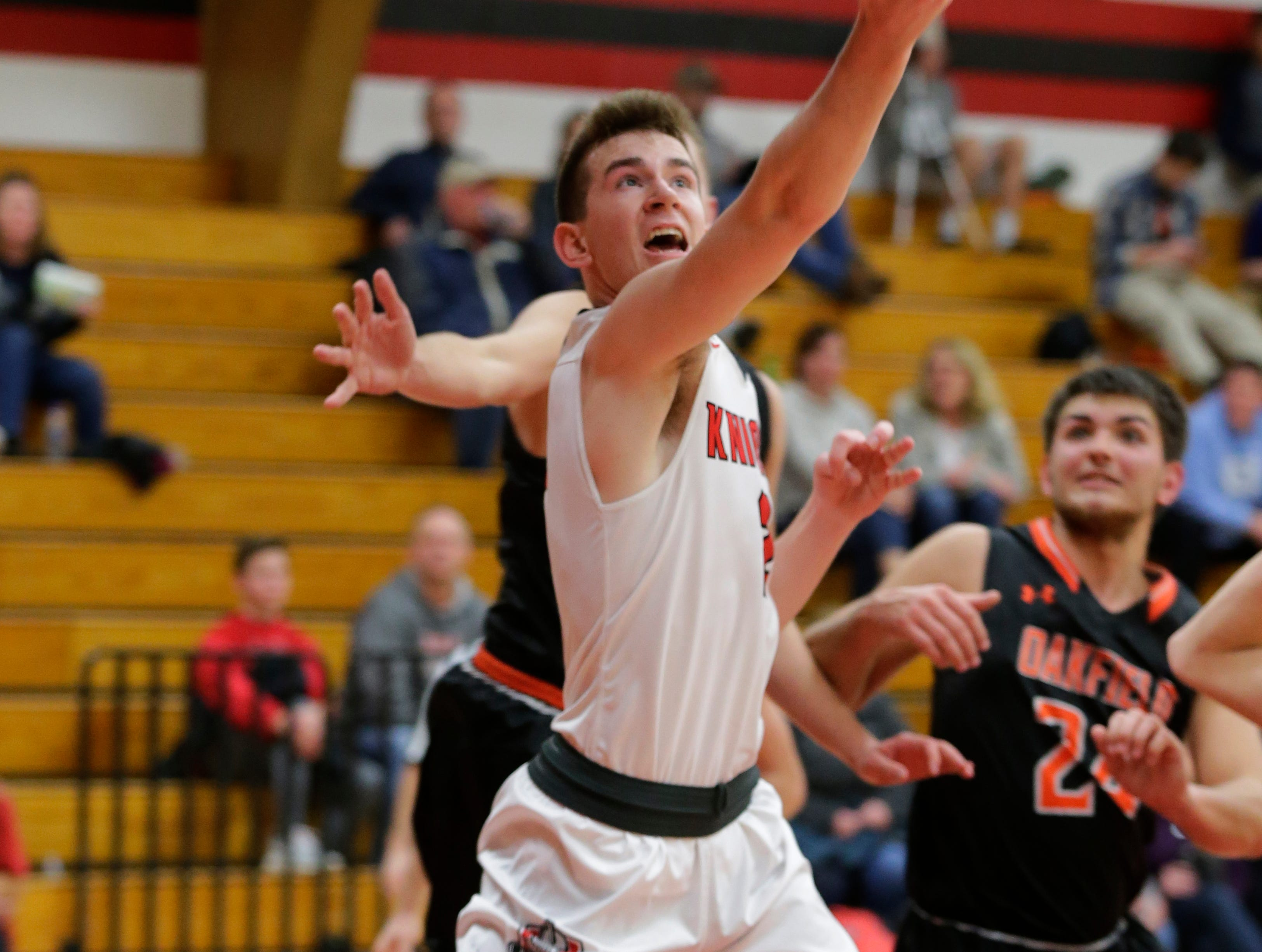 Lourdes Academy's Henry Noone goes in for a lay up.  Lourdes Academy Knights played Oakfield Oaks in boys basketball Tuesday, Dec. 4, 2018, at Lourdes Castle in Oshkosh, Wis.