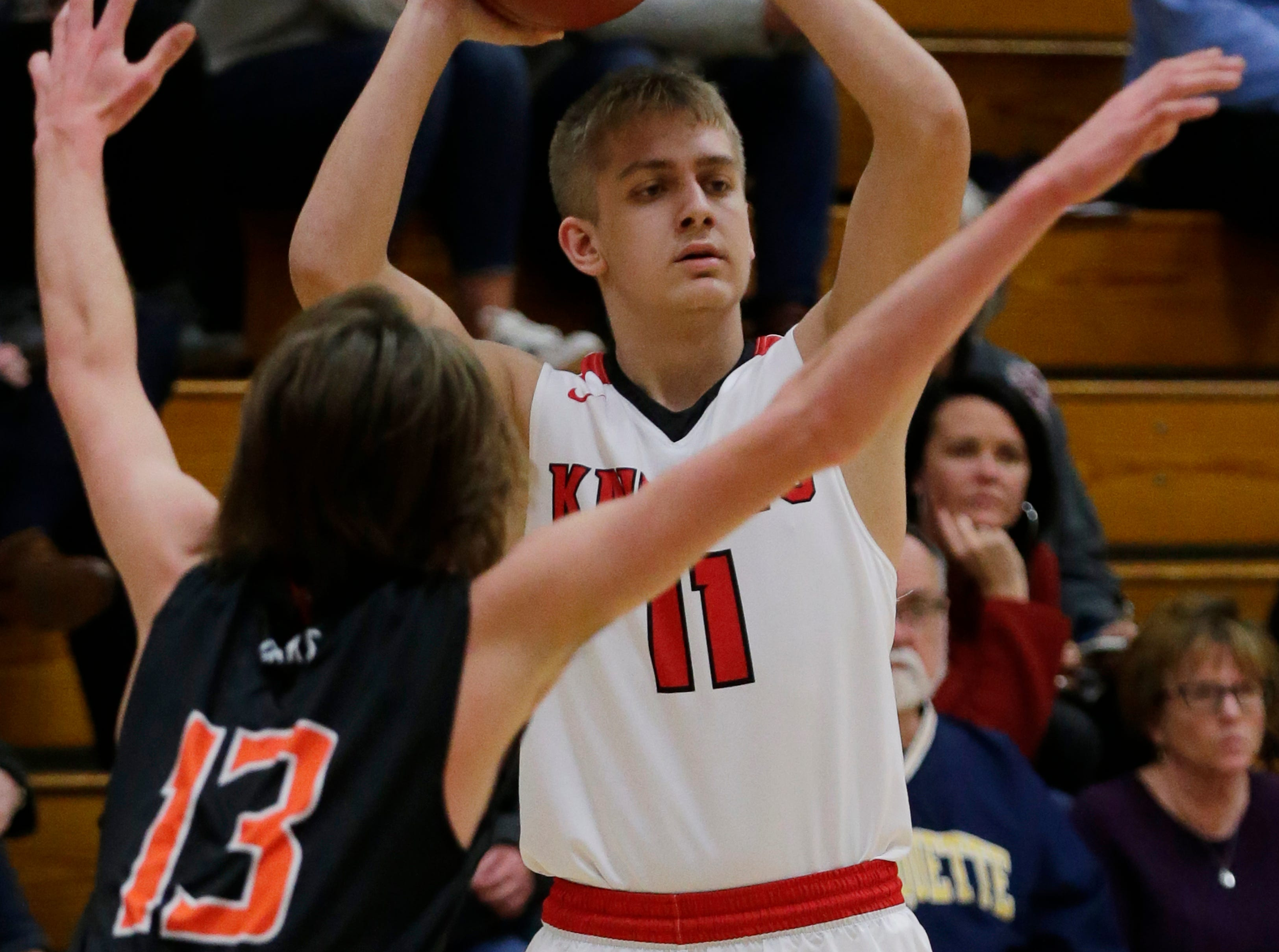 Lourdes Academy's Tyler Johnson looks to pass during the game.  Lourdes Academy Knights played Oakfield Oaks in boys basketball Tuesday, Dec. 4, 2018, at Lourdes Castle in Oshkosh, Wis.