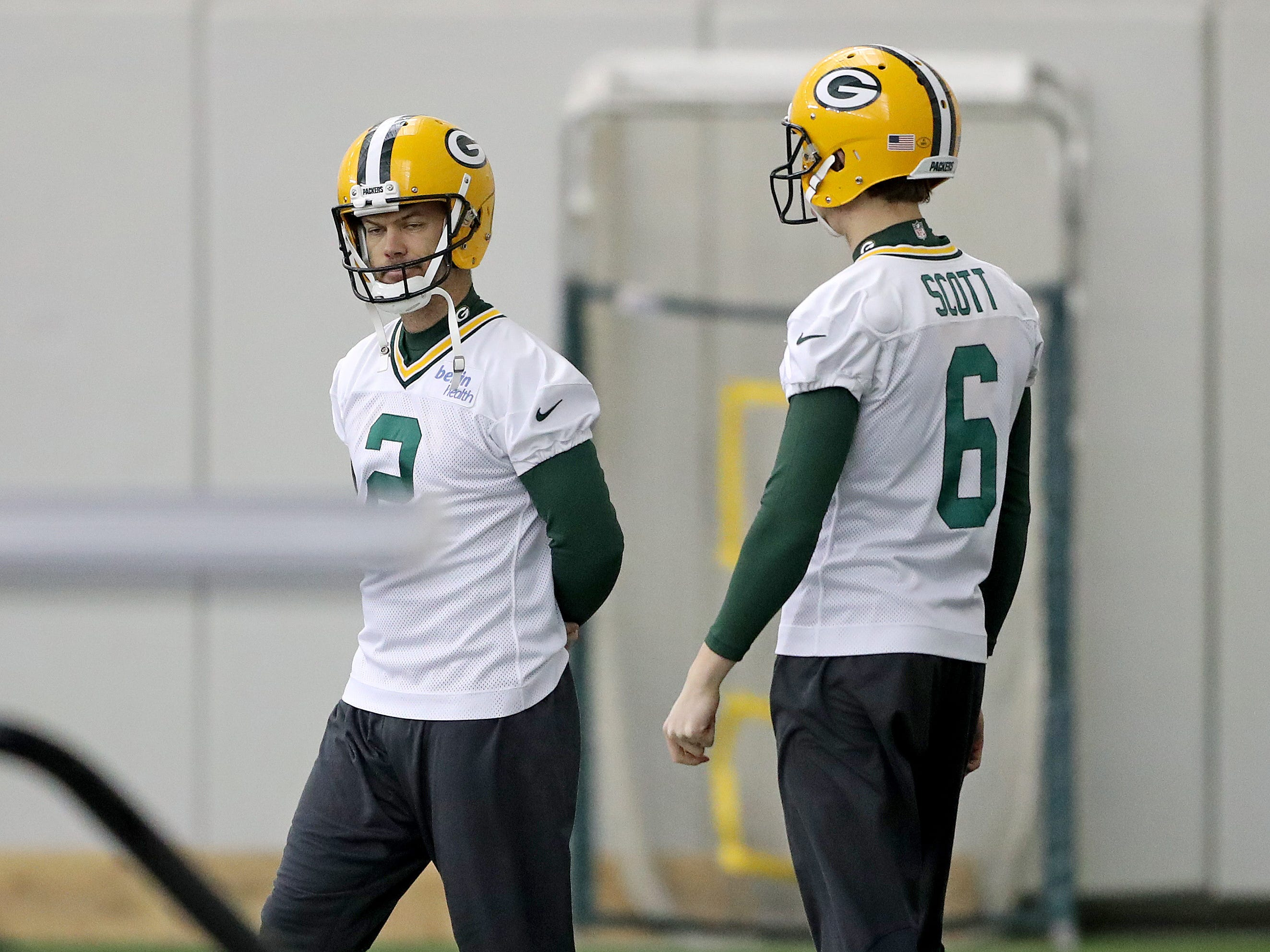 Green Bay Packers kicker Mason Crosby (2) talks with punter J.K. Scott (6) during practice Wednesday, December 5, 2018 inside the Don Hutson Center in Ashwaubenon, WIs.