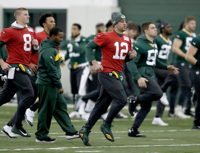 Green Bay Packers quarterback Aaron Rodgers (12) jogs during warmups during practice Wednesday, December 5, 2018 inside the Don Hutson Center in Ashwaubenon, WIs.