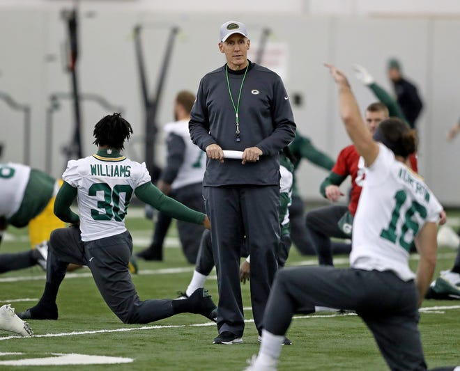 Green Bay Packers interim head coach Joe Philbin oversees warmups during practice Wednesday, December 5, 2018 inside the Don Hutson Center in Ashwaubenon, WIs.