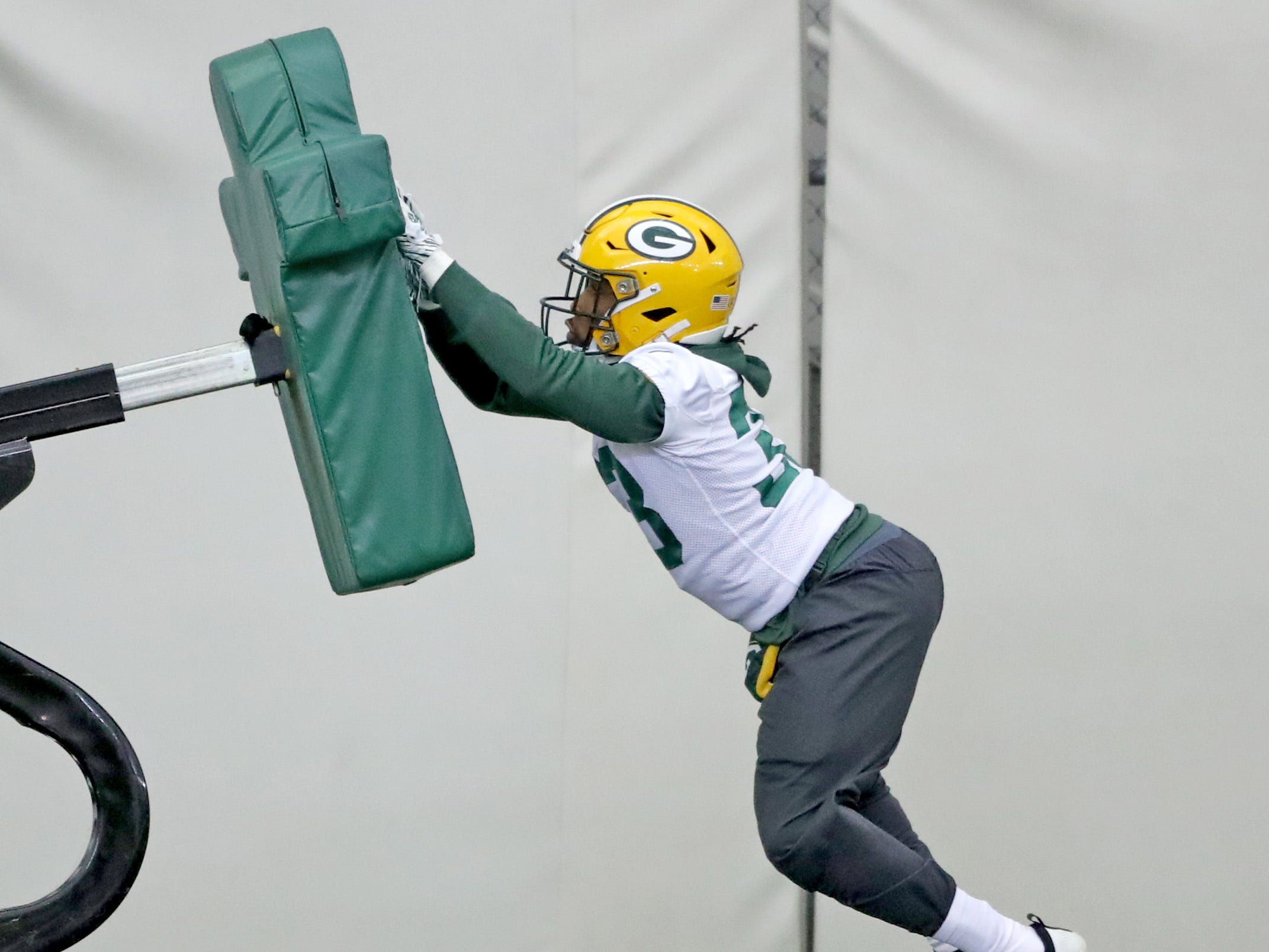 Green Bay Packers running back Aaron Jones (33) hits the blocking sled during practice Wednesday, December 5, 2018 inside the Don Hutson Center in Ashwaubenon, WIs.