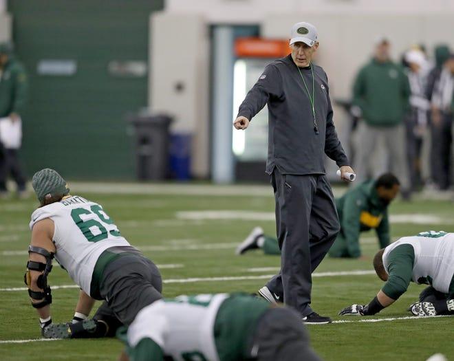 Green Bay Packers interim head coach Joe Philbin oversees warmups during practice Wednesday, December 5, 2018 inside the Don Hutson Center in Ashwaubenon, WIs.
