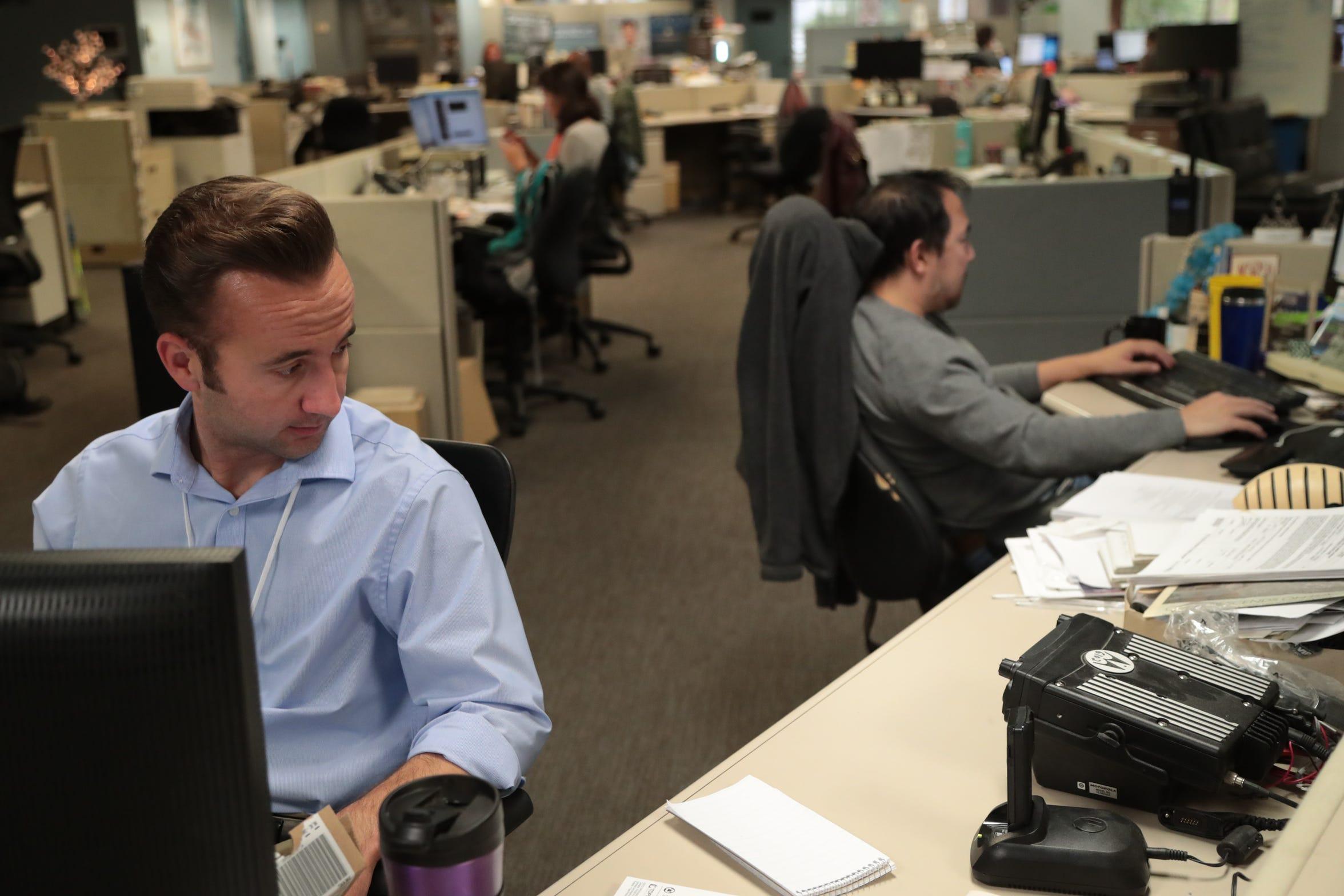 Reporter Shane Newell listens to the ERICA radio at the Desert Sun newsroom's breaking news desk, Wednesday, December 5, 2018.