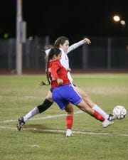 Dalia Gonzalez passing the ball. The Indio varsity soccer team lost Tuesday's home conference game against Cathedral City (CA) by a score of 7-0.