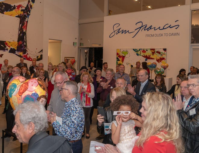More than 100 people came to meet the artists and see the hearts that will be auctioned off on February 4, 2019