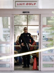 A heavily armed officer stands in the exit after a double fatal shootout between two men at the Toys R Us in Palm Desert, California, on Friday November 28, 2008.