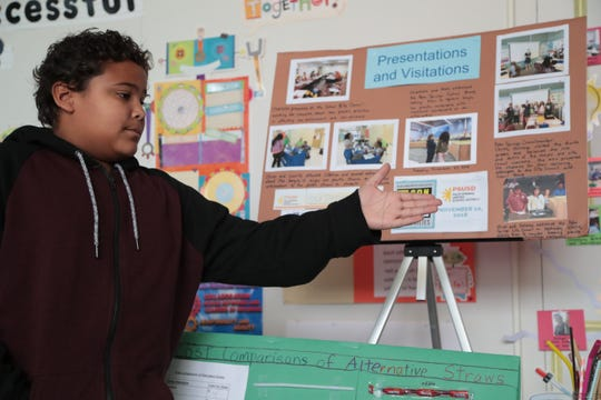 Fourth grade student Oliver Maxwell presents to a group, including Palm Springs City Councilmembers, on the findings he and his classmates made on the dangers of plastics, Wednesday, December 5, 2018.