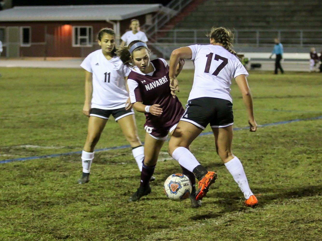 Navarre's Skylar Woods (18) and Niceville's Mia Sadler (17) collide into each other while battling for the ball in a District 1-4A showdown of unbeaten teams at Navarre High School on Tuesday, December 4, 2018. The game ended in a 1-1 tie.
