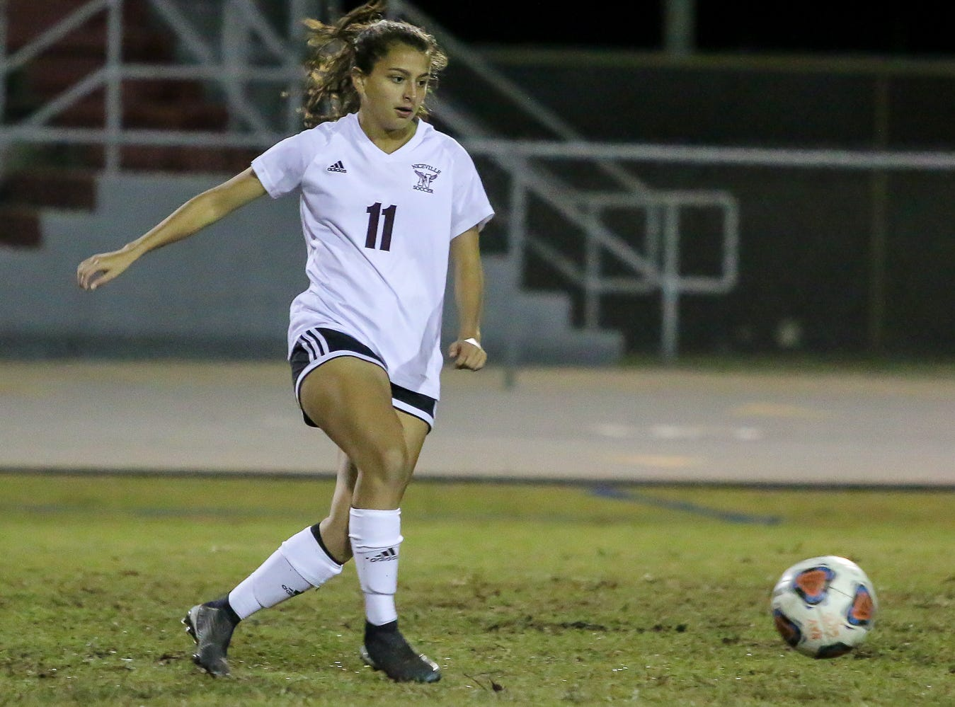 Niceville's Kayla Fernandez (11) passes the ball against Navarre in a District 1-4A showdown of unbeaten teams at Navarre High School on Tuesday, December 4, 2018. The game ended in a 1-1 tie.