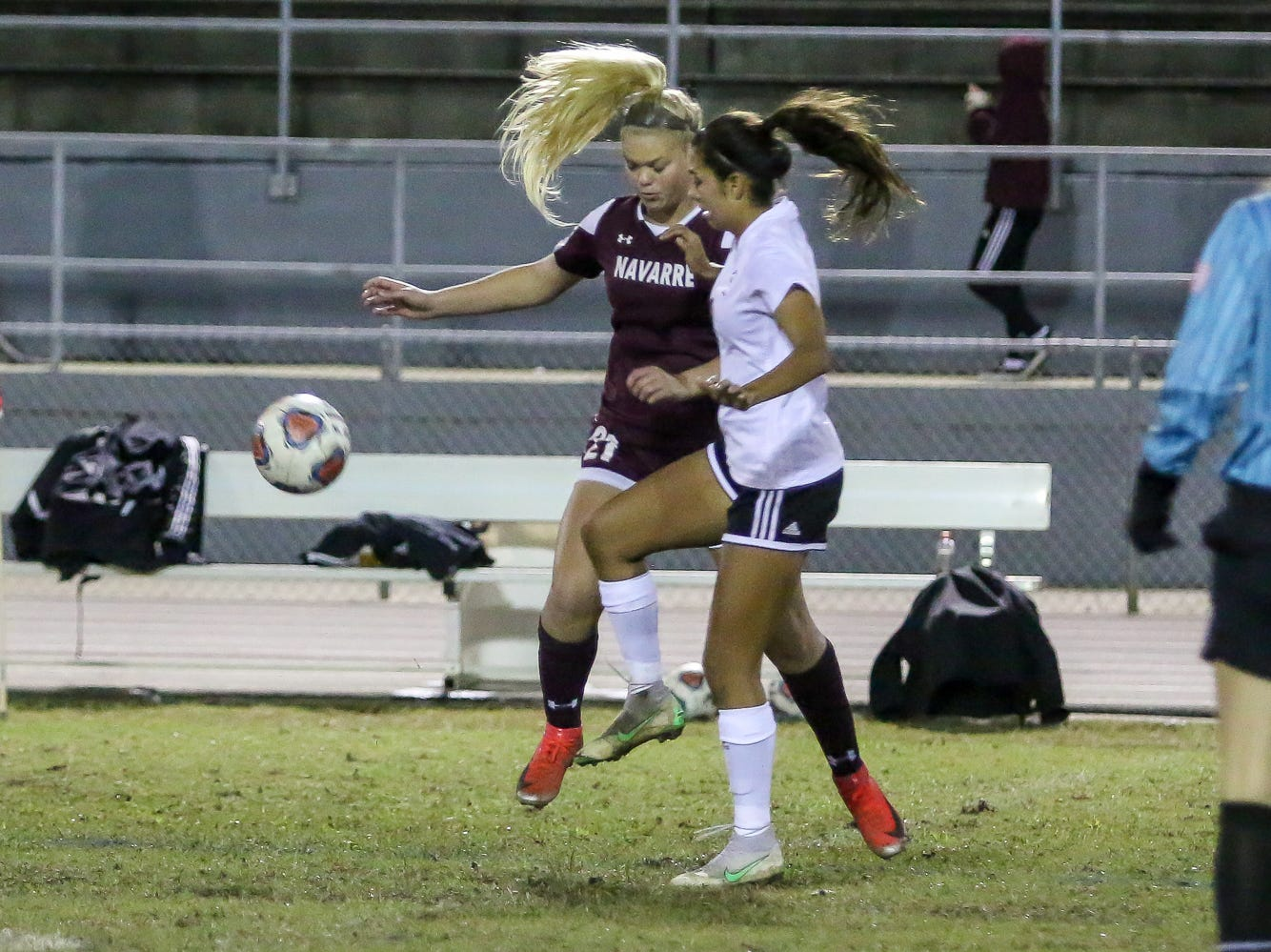 Navarre's Hunter Wallace (21) and Niceville's Liliana Fernandez (9) battle for control of the ball in a District 1-4A showdown of unbeaten teams at Navarre High School on Tuesday, December 4, 2018. The game ended in a 1-1 tie.