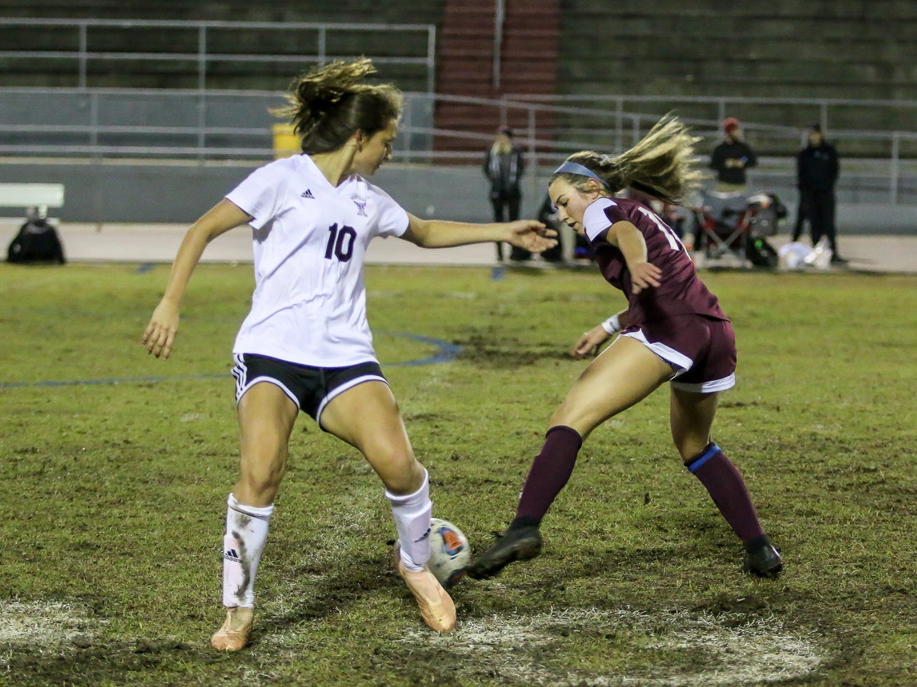 Navarre's Skylar Woods (18) makes a quick move to go behind Niceville's Ashlynn Fernandez (10) in a District 1-4A showdown of unbeaten teams at Navarre High School on Tuesday, December 4, 2018. The game ended in a 1-1 tie.
