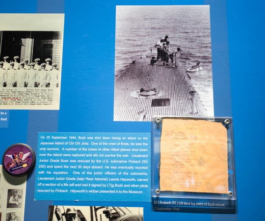Artifacts from his time as a Naval aviator, including from his rescue after being shot down during the attack on Chi Chi Jima, are part of the President George H.W. Bush display in the art gallery at the National Naval Aviation Museum in Pensacola on Wednesday, December 5, 2018.