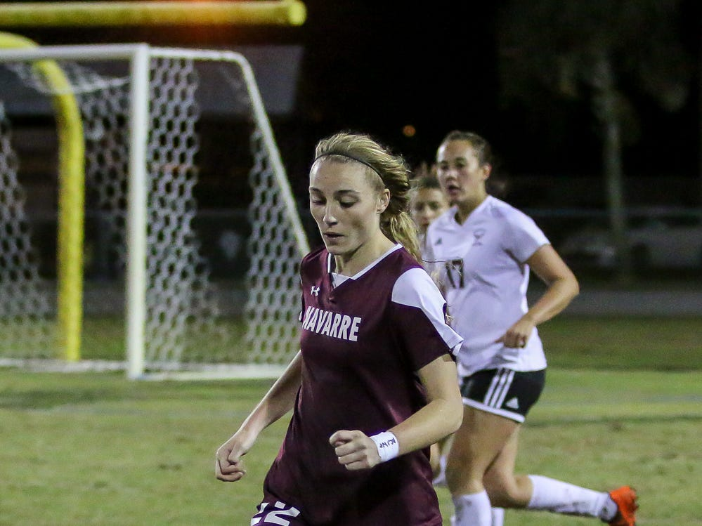Navarre's Jennifer Seward (22) dribbles the ball up the field against Niceville in a District 1-4A showdown of unbeaten teams at Navarre High School on Tuesday, December 4, 2018. The game ended in a 1-1 tie.