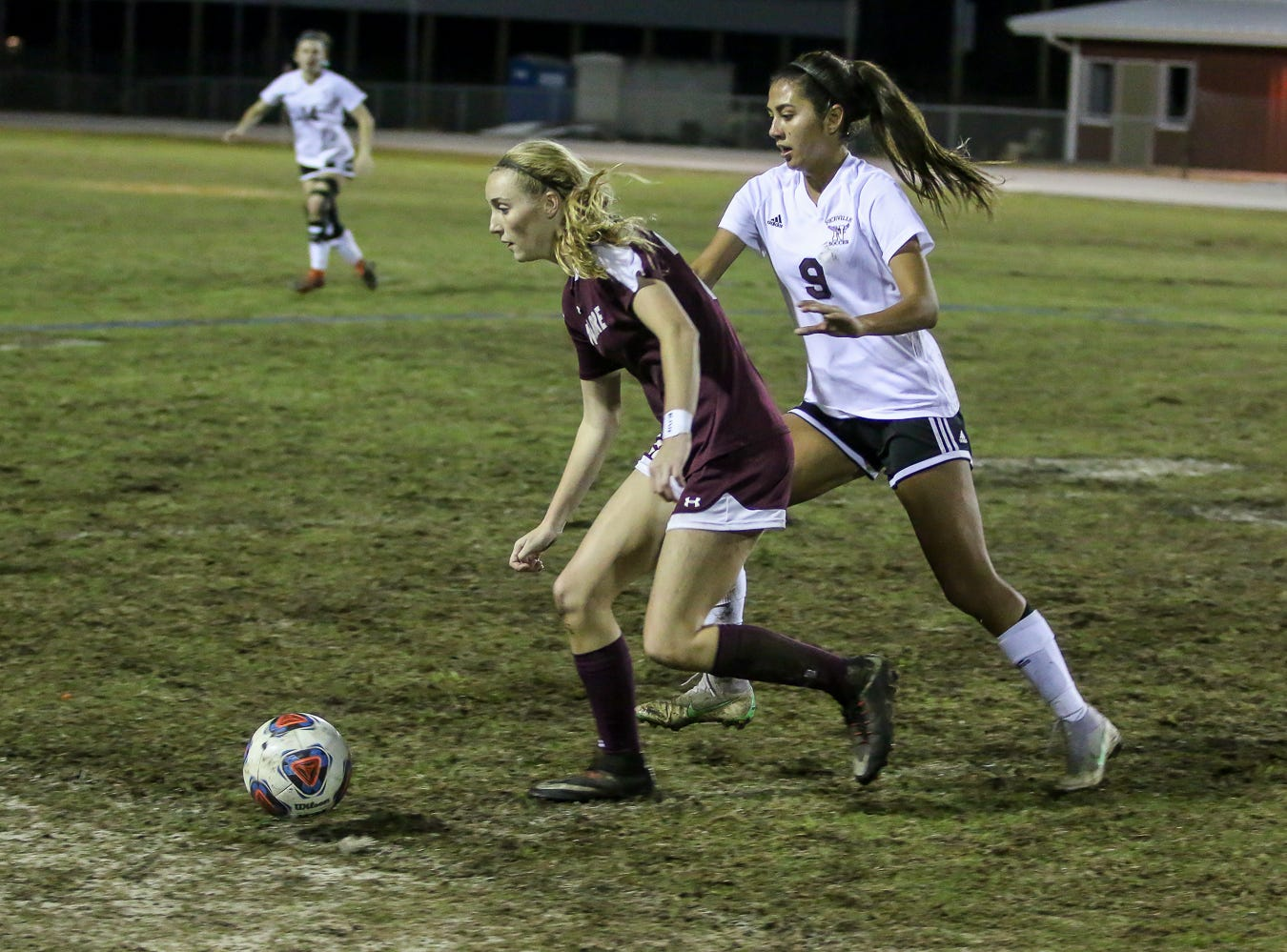 Navarre's Jennifer Seward (22) moves the ball away from Niceville's Liliana Fernandez (9) in a District 1-4A showdown of unbeaten teams at Navarre High School on Tuesday, December 4, 2018. The game ended in a 1-1 tie.