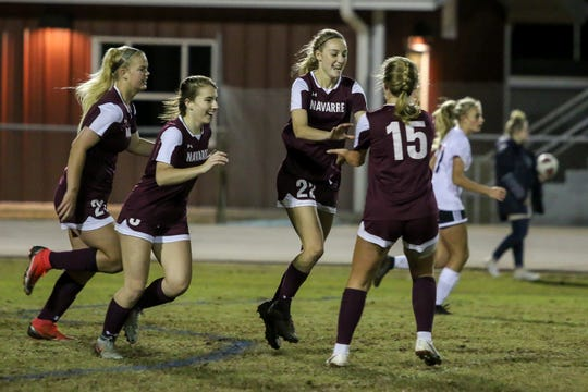 Navarre's Jennifer Seward (22) celebrates with teammates after she scored against Niceville in a District 1-4A showdown of unbeaten teams at Navarre High School on Tuesday, December 4, 2018. The game ended in a 1-1 tie.