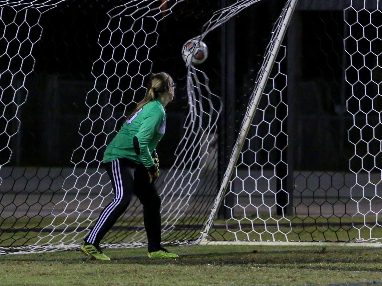 Niceville goaltender Megan Hague can only watch as a shot by Navarre's Jennifer Seward easily goes in for a point during a District 1-4A showdown of unbeaten teams at Navarre High School on Tuesday, December 4, 2018. The game ended in a 1-1 tie.