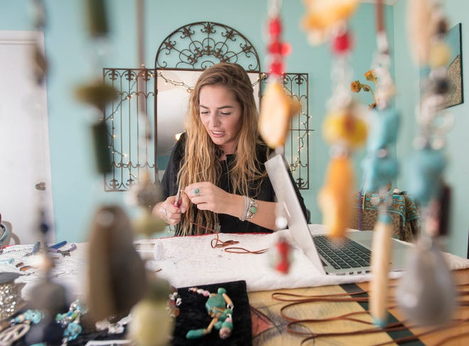 Elli Gentile, co-founder of I Love Me Knot, creates a piece of jewelry in Gulf Breeze on Wednesday. A portion of proceeds from I Love Me Know benefits those who have been impacted by suicide while reducing the stigma around mental illness.