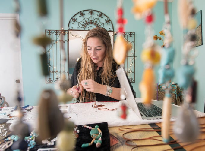 Elli Gentile, co-founder of I Love Me Knot, creates a piece of jewelry in Gulf Breeze on Wednesday, December 5, 2018.  A portion of their proceeds aids those who have been impacted by suicide while reducing the stigma around mental illness.