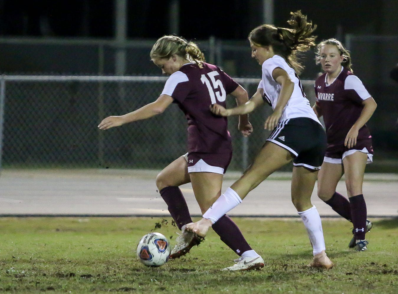Navarre's Autumn Slaybaugh (15) races past Niceville's Ashlynn Fernandez (10) in a District 1-4A showdown of unbeaten teams at Navarre High School on Tuesday, December 4, 2018. The game ended in a 1-1 tie.