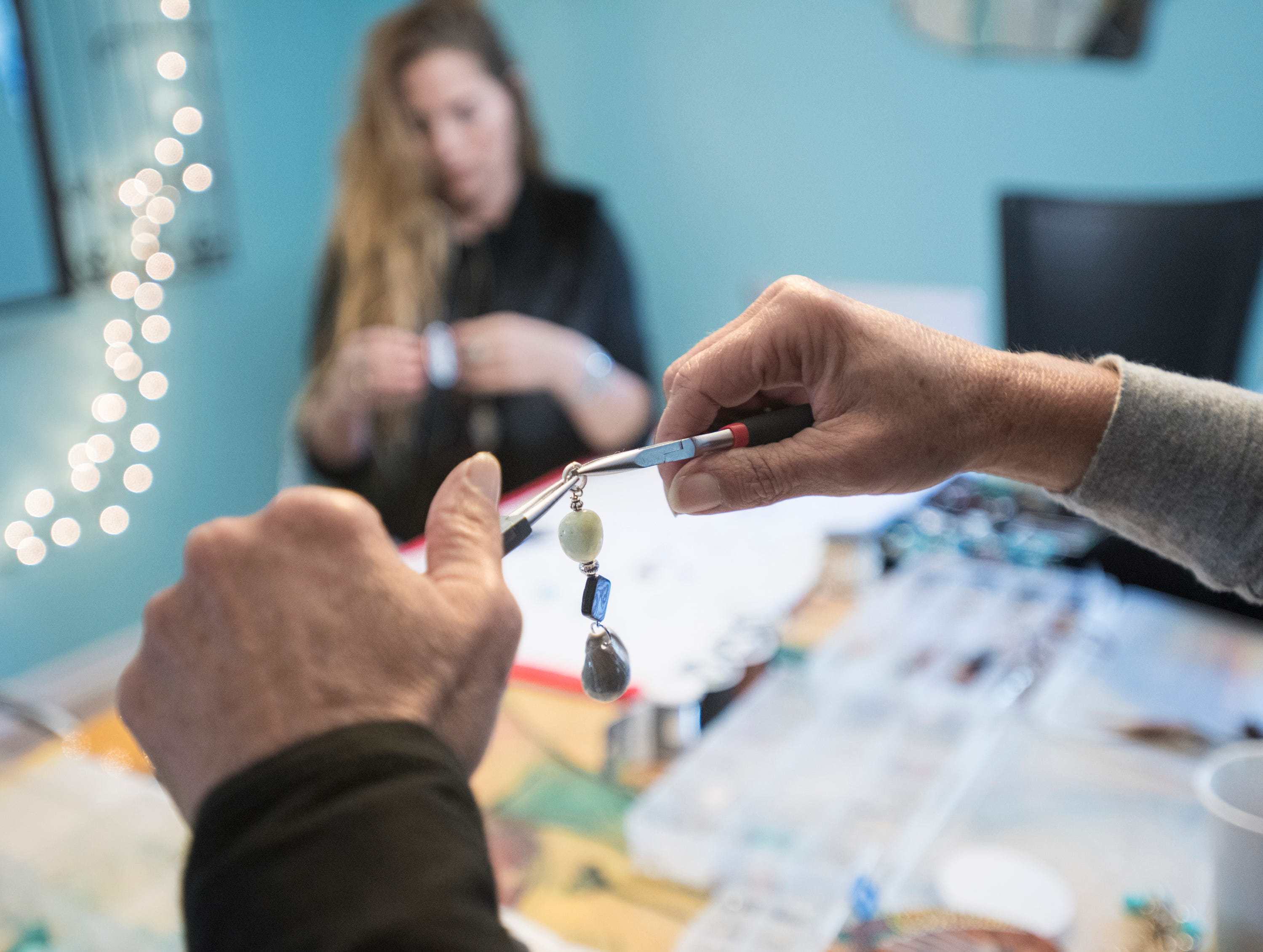 Mary Gentile, foreground, and her daughter Elli, co-founders of I Love Me Knot, create jewelry in Gulf Breeze on Wednesday, December 5, 2018.  A portion of their proceeds aids those who have been impacted by suicide while reducing the stigma around mental illness.
