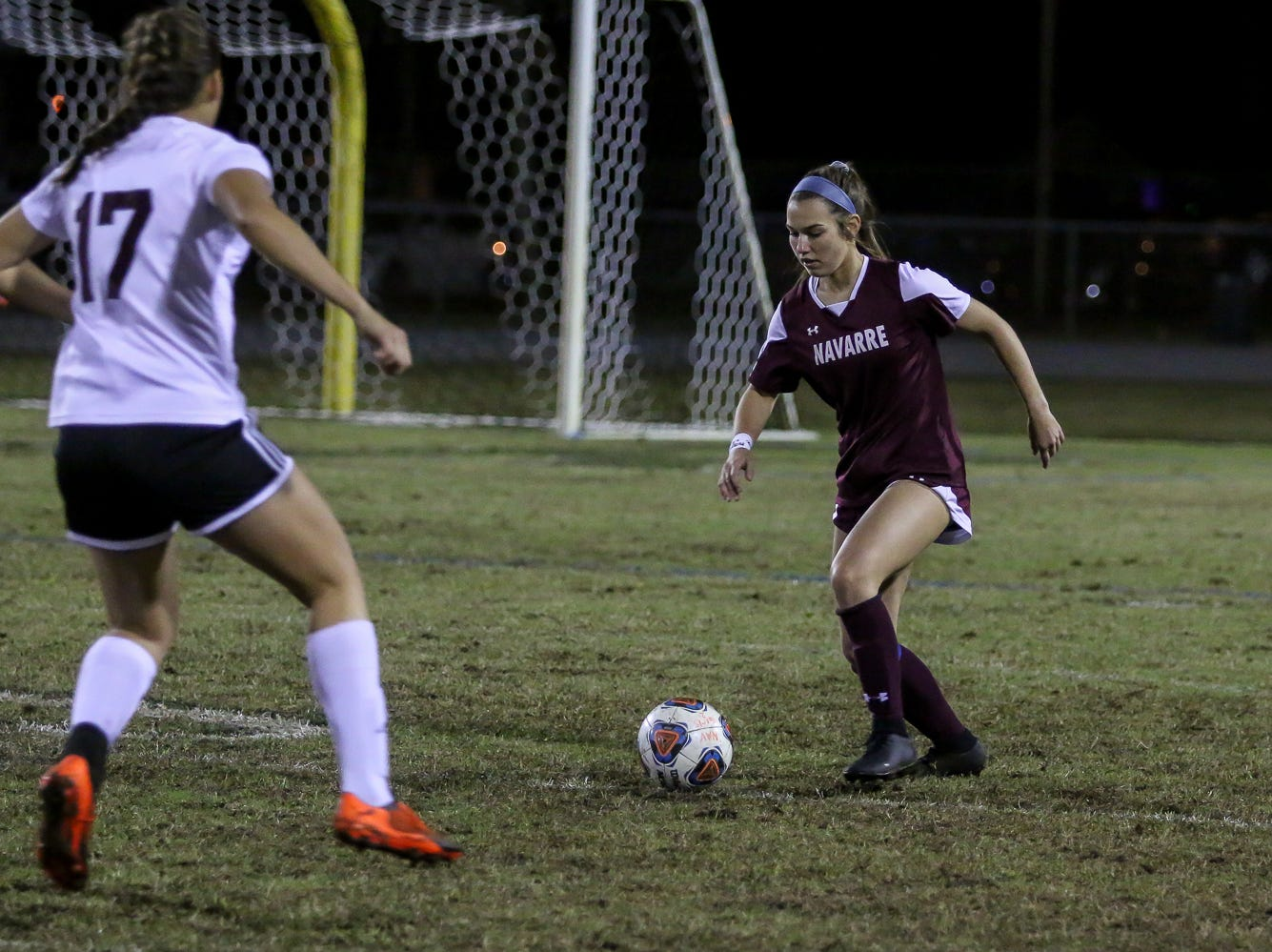 Navarre's Skylar Woods (18) works the ball to get around Niceville's Mia Sadler (17) in a District 1-4A showdown of unbeaten teams at Navarre High School on Tuesday, December 4, 2018. The game ended in a 1-1 tie.