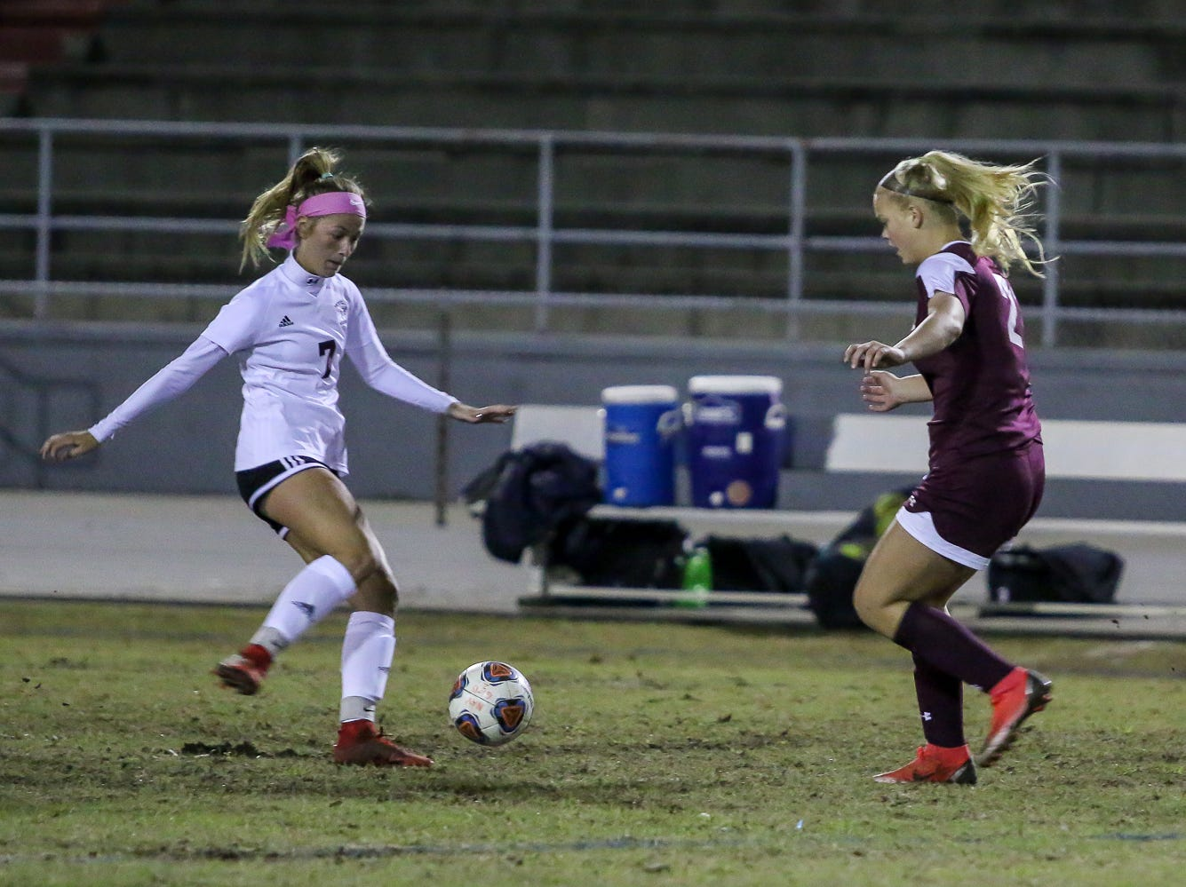 Navarre's Hunter Wallace (21) takes on Niceville's Avery Hanson (7) in a District 1-4A showdown of unbeaten teams at Navarre High School on Tuesday, December 4, 2018. The game ended in a 1-1 tie.