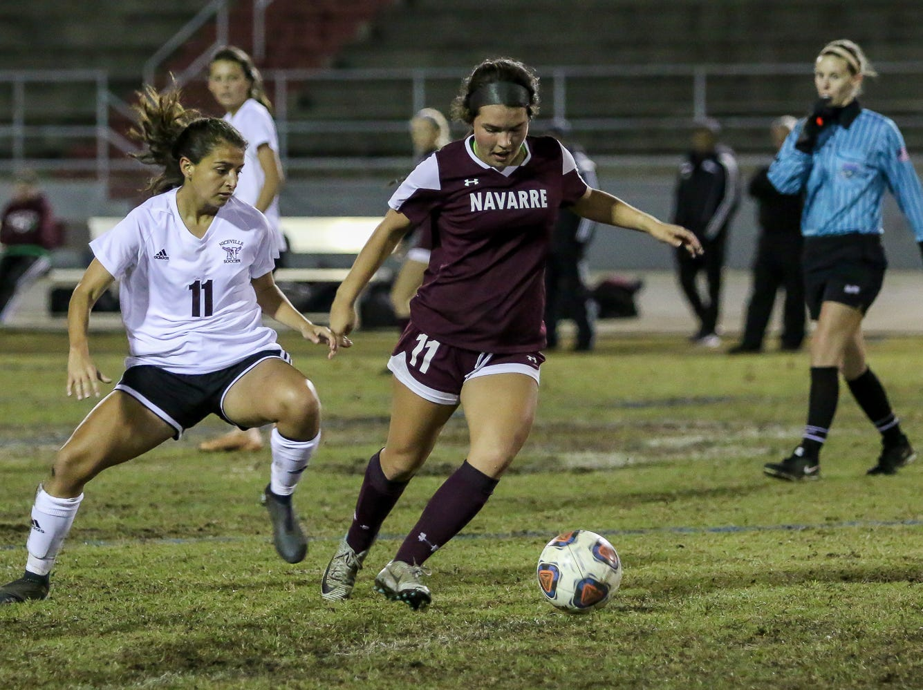 Niceville's Kayla Fernandez chases after Navarre's Anakah Madril in a District 1-4A showdown of unbeaten teams at Navarre High School on Tuesday, December 4, 2018. The game ended in a 1-1 tie.