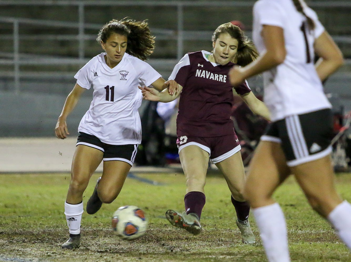 Niceville's Kayla Fernandez (11) and Navarre's Jocelyn Fernandez (5) battle for control of the ball in a District 1-4A showdown of unbeaten teams at Navarre High School on Tuesday, December 4, 2018. The game ended in a 1-1 tie.