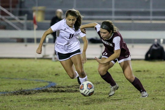 Niceville's Kayla Fernandez and Navarre's Anakah Madril chase after the ball in a District 1-4A showdown of unbeaten teams at Navarre High School on Tuesday, December 4, 2018. The game ended in a 1-1 tie.