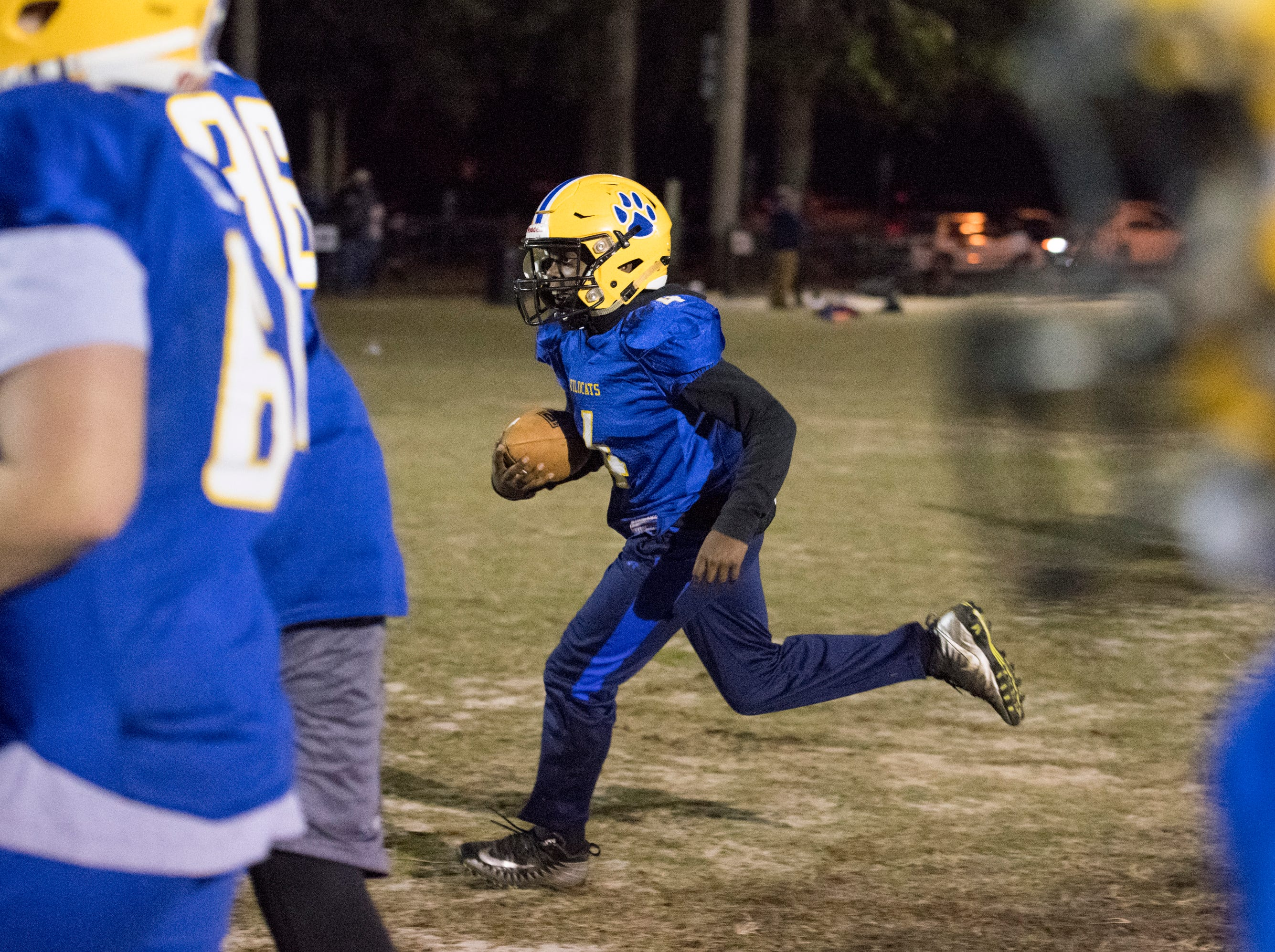 Nigel Nelson (4) carries the ball as the NEP 11U youth football team practices at the Roger Scott football field in Pensacola on Tuesday, December 4, 2018.