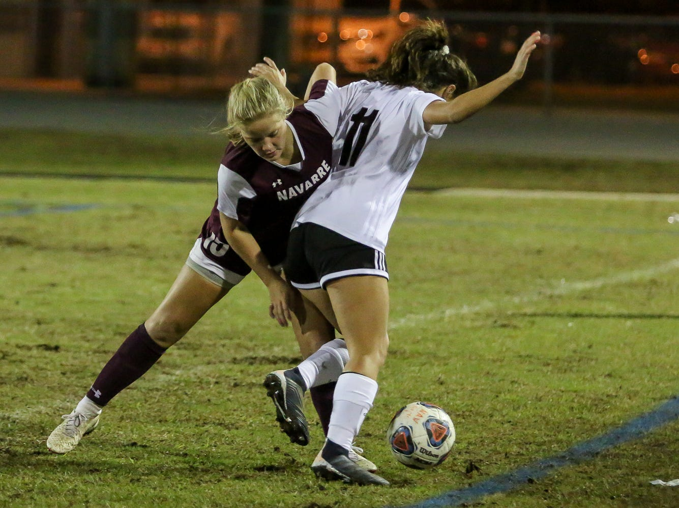 Navarre's Autumn Slaybaugh (15) works to keep Niceville's Kayla Fernandez (11) from passing the ball in a District 1-4A showdown of unbeaten teams at Navarre High School on Tuesday, December 4, 2018. The game ended in a 1-1 tie.