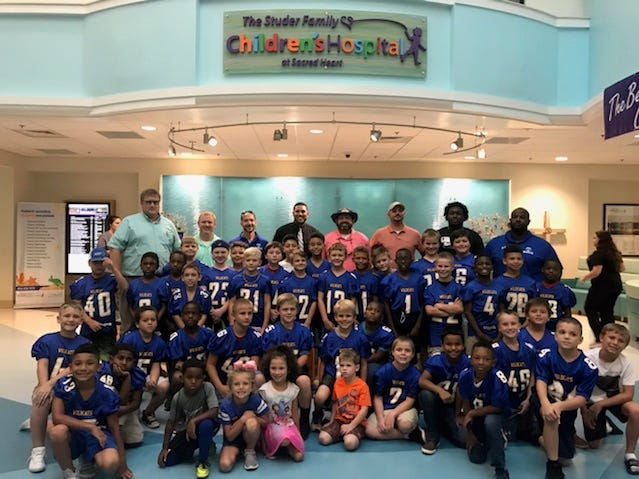 The NEP Wildcats handed out goodie bags on Halloween at Sacred Heart Children's Hospital.