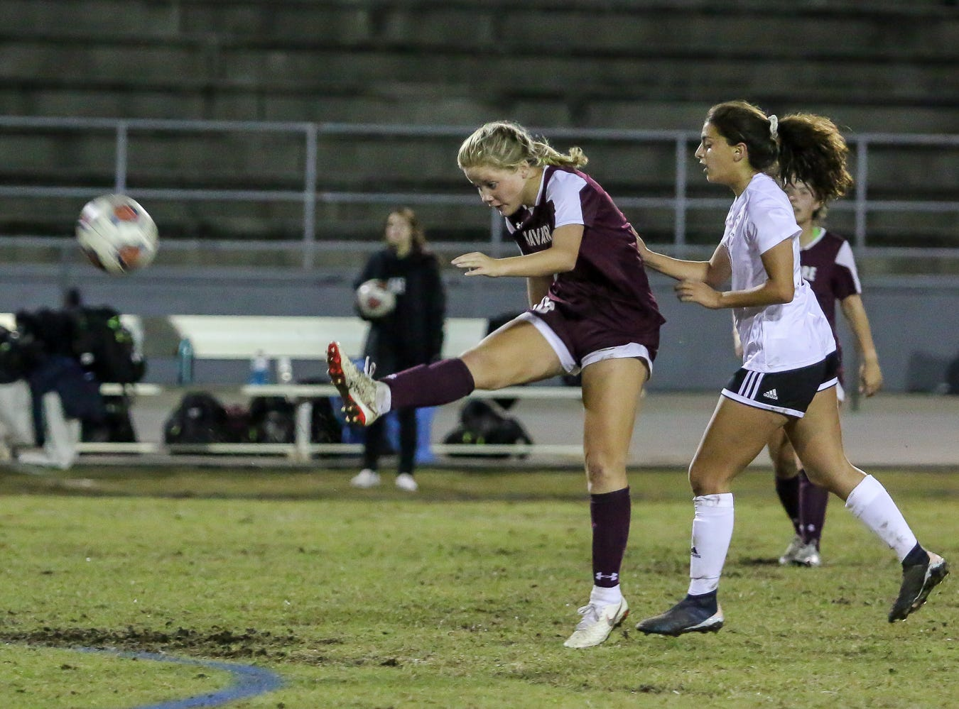 Navarre's Autumn Slaybaugh (15) kicks a long pass into the Niceville zone in a District 1-4A showdown of unbeaten teams at Navarre High School on Tuesday, December 4, 2018. The game ended in a 1-1 tie.