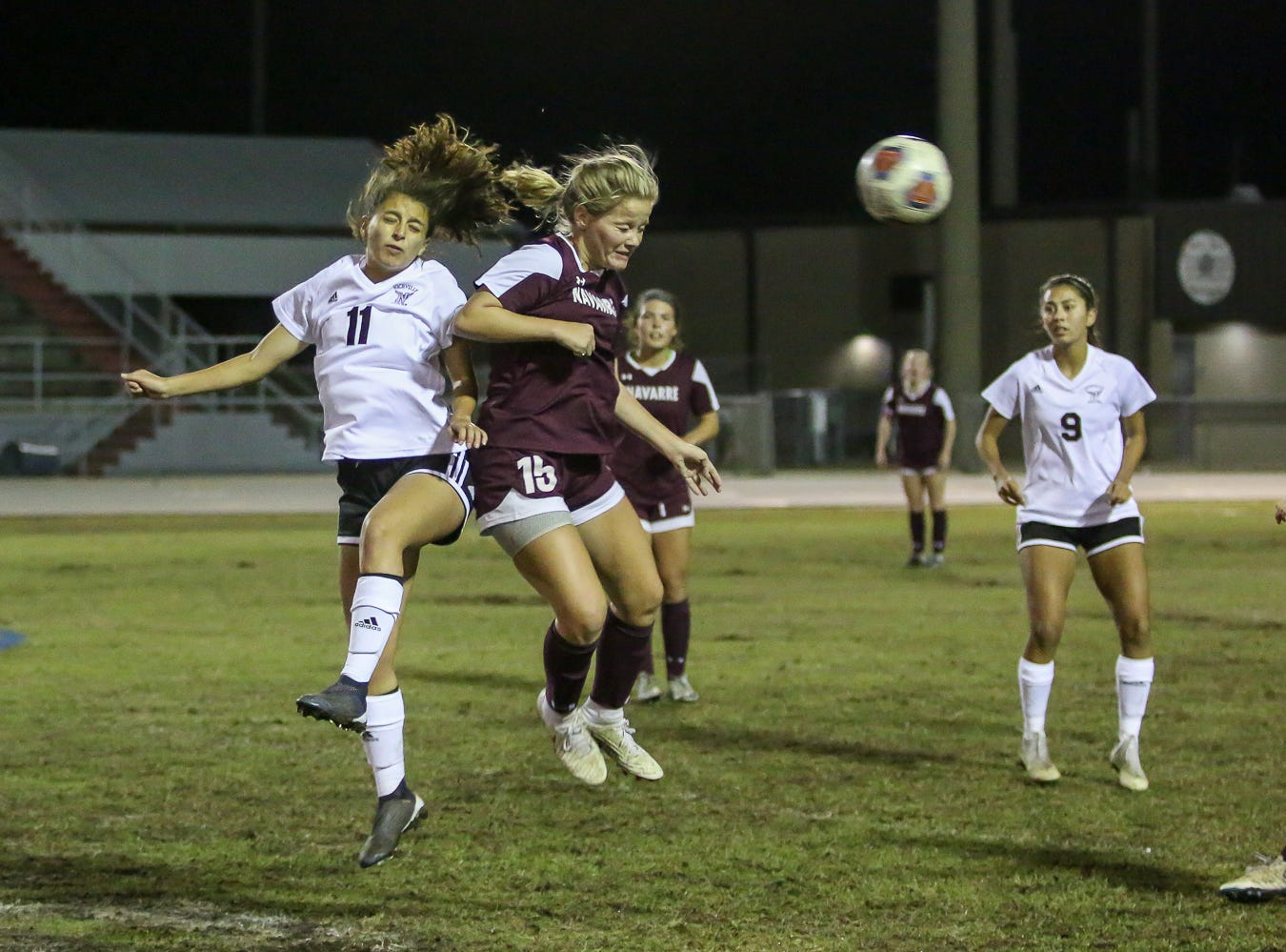 Niceville's Kayla Fernandez (11) and Navarre's Autumn Slaybaugh (15) go up for a header to get control of the ball in a District 1-4A showdown of unbeaten teams at Navarre High School on Tuesday, December 4, 2018. The game ended in a 1-1 tie.