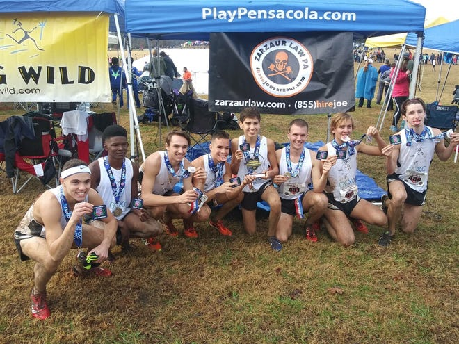 The Gulf Coast Cross Country team  poses after taking second at the AAU National Championships in Knoxville, Tennessee, last weekend. Pictured left to right: David Milburn, Richard Whatley, John Trawick, Brandon Kneija, Francisco Ramirez, Daniel Holtzknecht, James Simkins, Jr., and Rory Carmody.