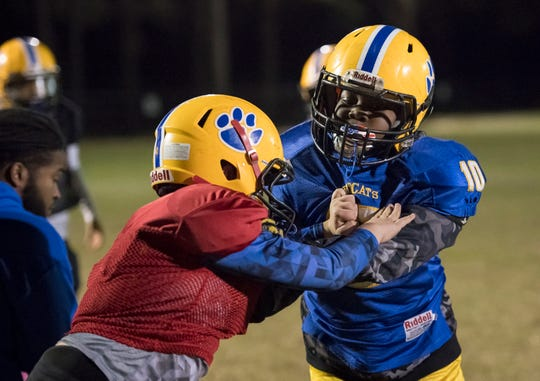 The NEP 9U youth football team practices at the Roger Scott football field in Pensacola on Tuesday, December 4, 2018.