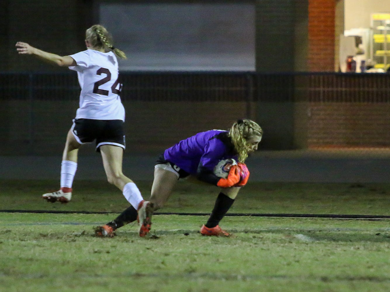 Navarre goaltender Jessika Seward (8) comes out of the goal to scoop up the loose ball  in a District 1-4A showdown of unbeaten teams against Niceville at Navarre High School on Tuesday, December 4, 2018. The game ended in a 1-1 tie.