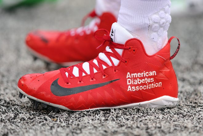 New York Giants linebacker Kareem Martin (96) wears special cleats for the NFL promotion my cause my cleats before a game against the Chicago Bears at MetLife Stadium.