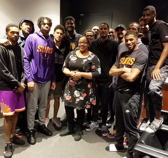Dec. 3, 2018; Former NBA player Etan Thomas stands with Emerald Garner and Phoenix Suns.