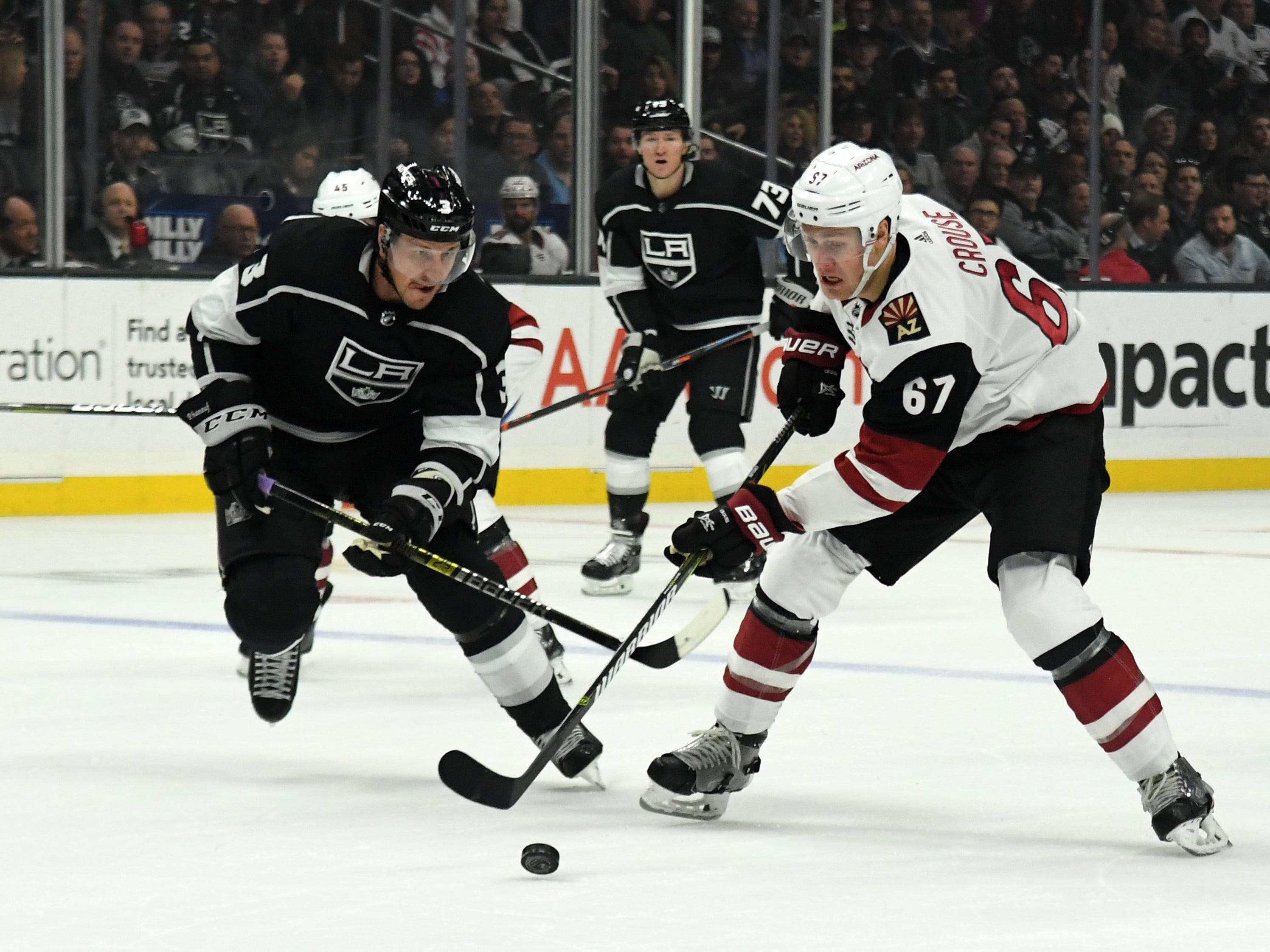 Dec 4, 2018; Los Angeles, CA, USA; Arizona Coyotes left wing Lawson Crouse (67) and Los Angeles Kings defenseman Dion Phaneuf (3) battle for the puck in the first period at Staples Center. Mandatory Credit: Kirby Lee-USA TODAY Sports