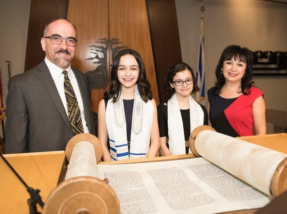 Randy and Terri Udelman chose to raise their daughters in the Jewish faith but still try to incorporate Terri's heritage.